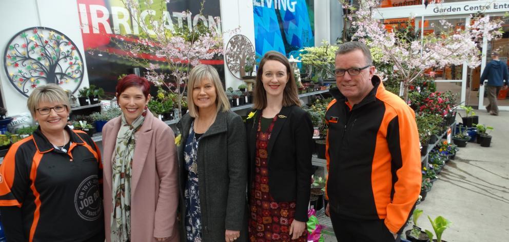 Cancer Society Otago-Southland representatives meet  Mitre 10 Mega representatives to mark the...