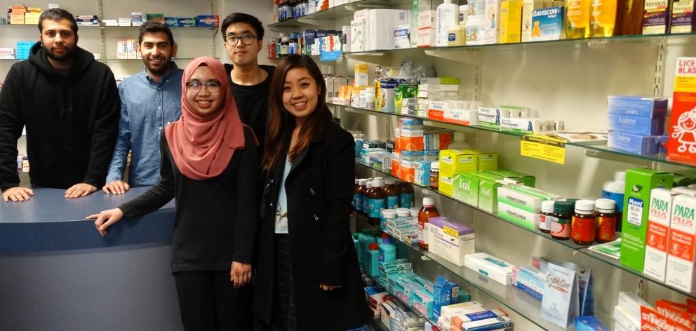 Final-year pharmacy students (from left) Harichandra Chhagan (24), Ali Adeeb (21), Fairuz Hashim ...