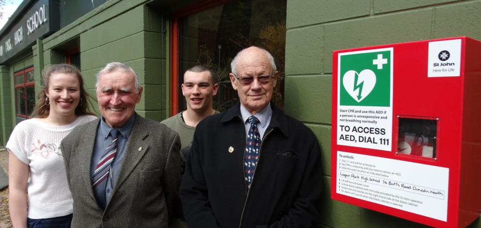 Admiring the new 24/7 access defibrillator at Logan Park High School are (from left) head girl...