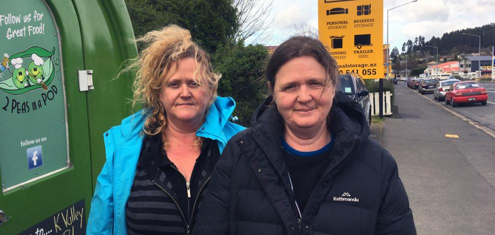 2 Peas in a Pod co-owners Janine (left) and Raewyn Hastie outside their coffee cart in Kaikorai Valley Rd, where people park vehicles for sale. Photo: Shawn McAvinue