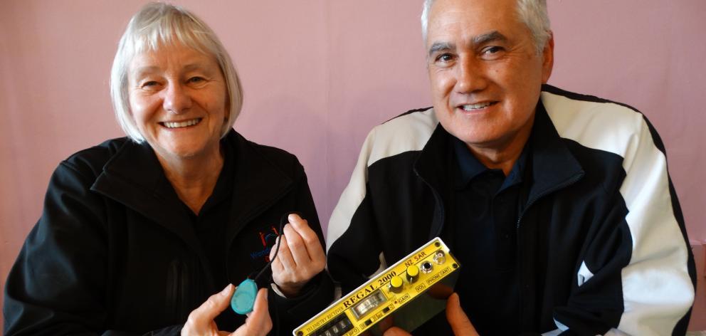 Dunedin LandSAR WandaTrak liaison and administrator Kay Raw holds a radio frequency emitting...