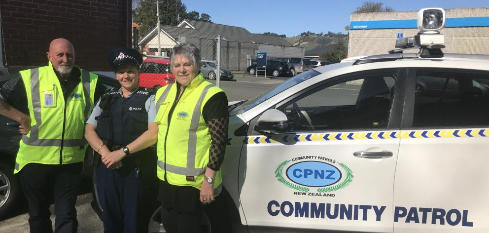 Standing with the new patrol vehicle are (from left) Mosgiel-Taieri Community Patrol chairman...