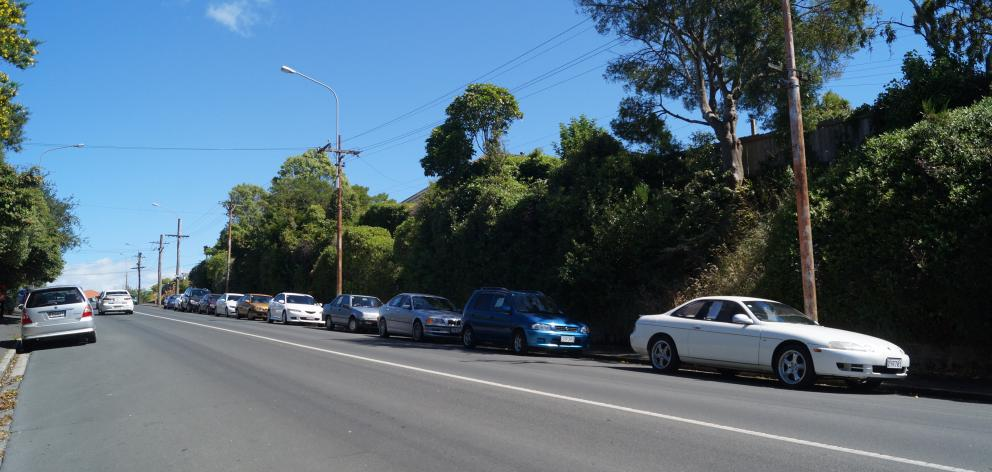 The number of cars for sale parked along Mailer St in Mornington, towards Kenmure Rd, has been...
