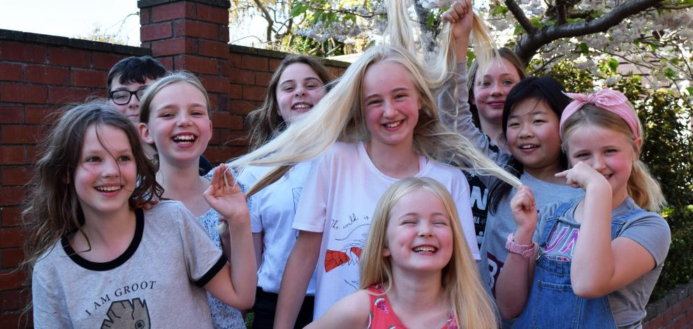 Play with the hair of Aoife Sievwright (11) before she it gets chopped off for charity  are...