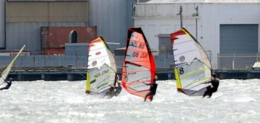 Competitors in the New Zealand slalom windsurfing championships in the Otago Harbour on Saturday. Photo by Craig Baxter.
