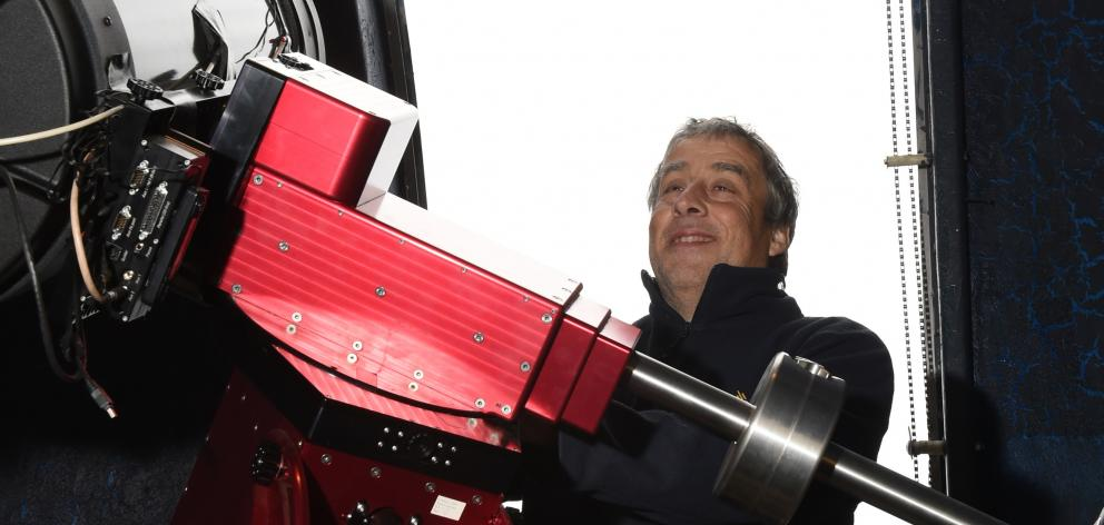 French astronomer Francois Colas, of the Paris Observatory, looks over a 35cm telescope at...