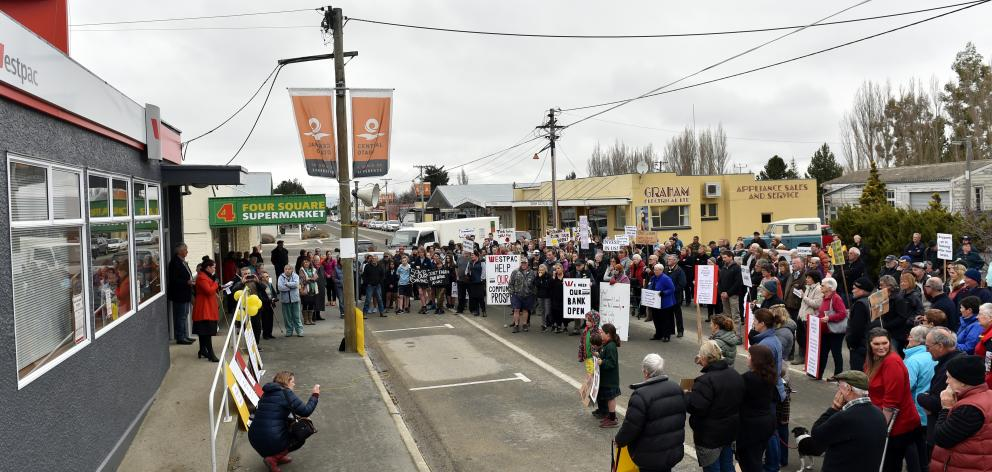 Ranfurly's main street was blocked for about an hour yesterday, as protesters gathered outside...
