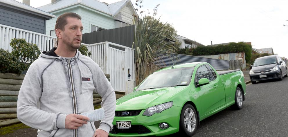 Port Chalmers resident Ryan Henry is unhappy that both he and his father-in-law were ticketed for...