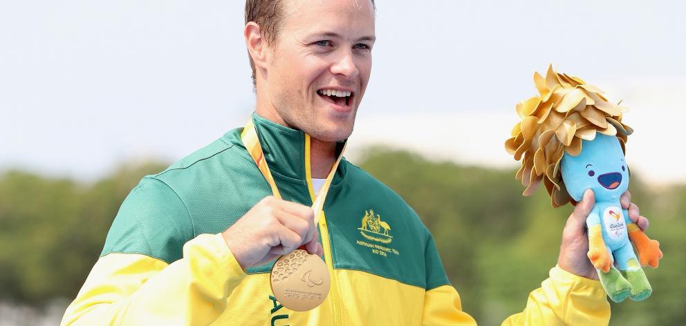 Curtis McGrath of Australia stands on the medals podium at Lagoa Stadium during day 8 of the Rio...