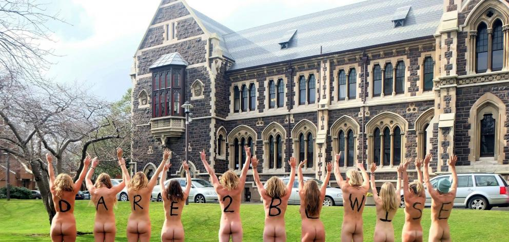 University of Otago Fossil Free Otago group members bare all to show the university how passionate they are about divestment at the university campus on Monday. Photo supplied.