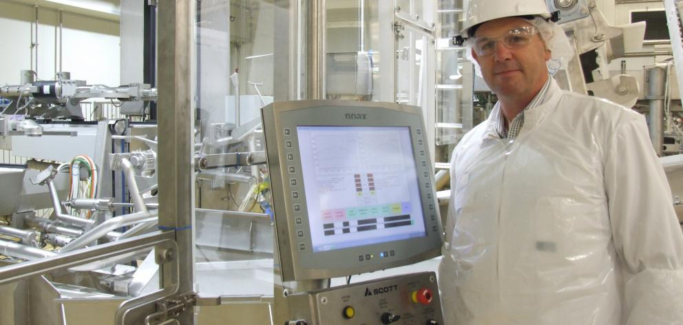 Alliance Group Pukeuri plant manager Geoff Proctor views  robotic technology in the boning room....