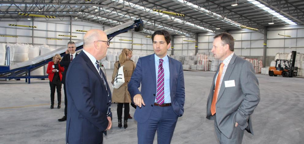 Transport Minister Simon Bridges (centre) officially opens South Port's new intermodal freight...
