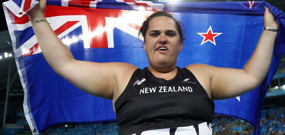 Jessica Hamill celebrates after taking bronze in the Women's Shot Put F34 final on day 7 of the...