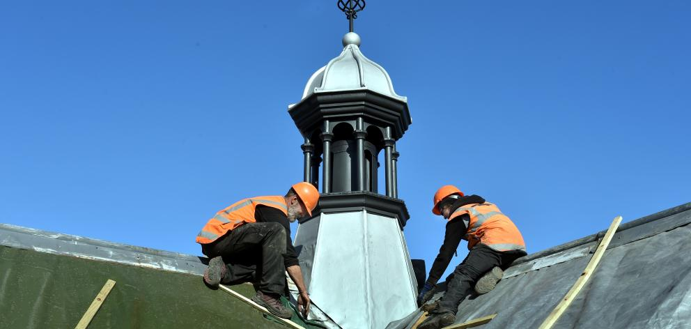 Cameron Roofing specialist slatters Chris Edwards (left) and Blair Allen work on the fleche of...