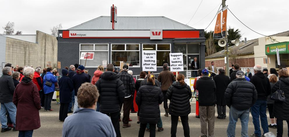 Locals gather outside the Westpac Bank in Ranfurly to protest its closure. PHOTO: PETER MCINTOSH