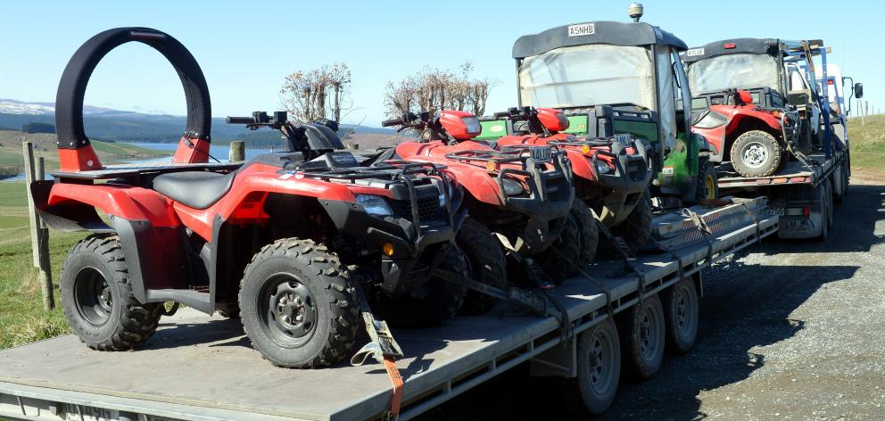 Quad bikes now redundant from Landcorp properties are moved by truck and trailer.