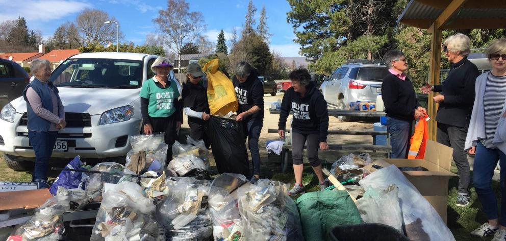 Don't Chuck Your Muck anti-littering campaigners show some of the 250kg of litter they collected in Wanaka last week. Campaign co-founder Mandy Kain said the group wanted to change the attitude some people had towards littering before it was too late. Pho