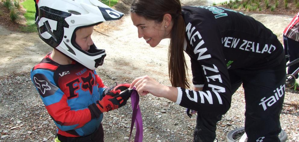 Keen Mosgiel BMX rider Cody Heger (5)  admires Sarah Walker's Olympic silver BMX medal. Photos:...