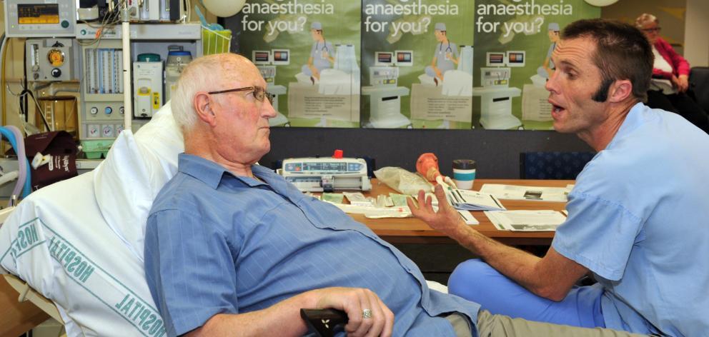 Anaesthesia specialist Jason Henwood (right) talks Jim Williamson through the benefits of...