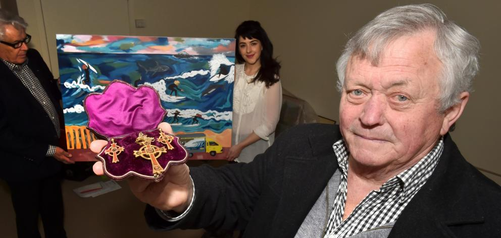 Abbeyfield Antiques Roadshow master of ceremonies Dougal Stevenson (right) shows an example of Celtic garniture as antiques appraiser Barry Forno and artist Pia Davie display her work Surf School St Clair, both of which are among items to be auctioned at
