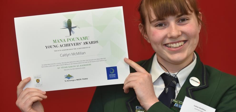 Columba College year 13 pupil Caitlyn McMillan (17) holds a Manu Pounamu certificate...