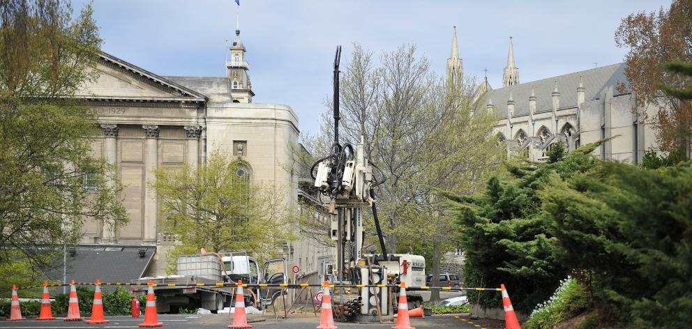 A drilling rig was moved on to the Filleul St car park in central Dunedin yesterday to begin work to assess the site's suitability as the possible future home of an 18-storey five-star hotel. Photo by Christine O'Connor.