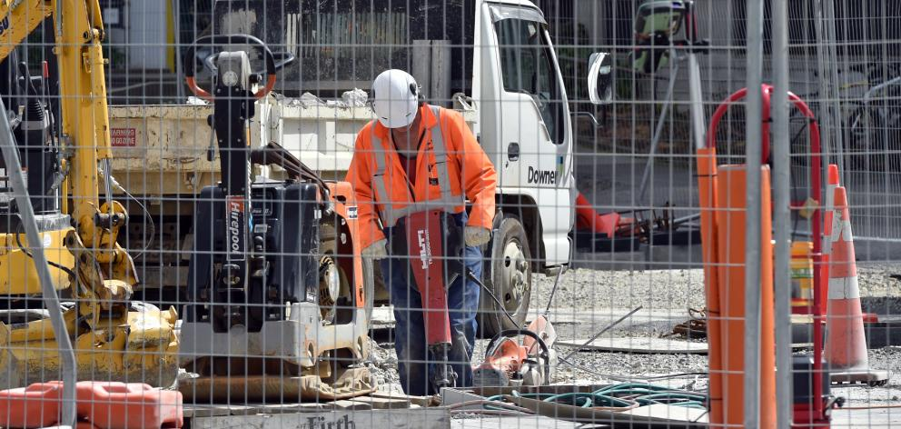 A worker uses a jackhammer during landscaping construction work at the University of Otago campus...