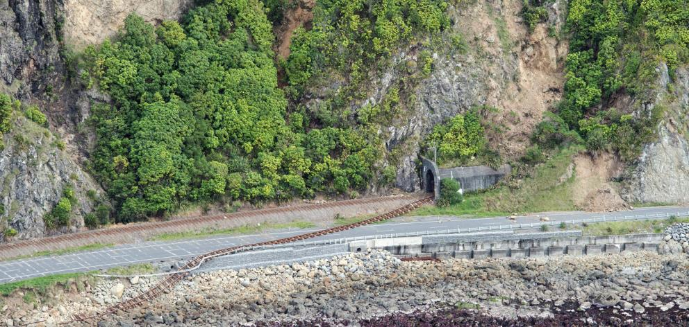 Damaged railway track across State Highway 1. Photo: Reuters