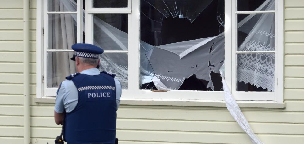 A police officer makes a call from the scene of an incident on Saturday afternoon in which a man...