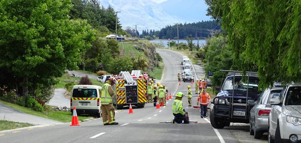 Peninsula Rd, in Queenstown, is  blocked as fire crews fight a blaze caused when an 11,000-volt...