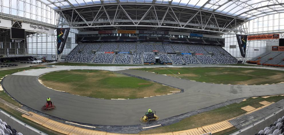 A concrete track sets at Forsyth Barr Stadium yesterday in preparation for the  ''D1NZ Drifting:...