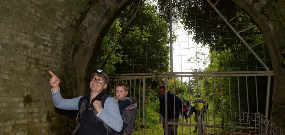 Chris and Niko (20 months) Dzikiewicz start their journey from the Wingatui end of the Chain...