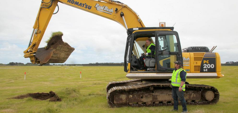 Economic Development Minister Steven Joyce does some site work at the Southern Dairy Hub...