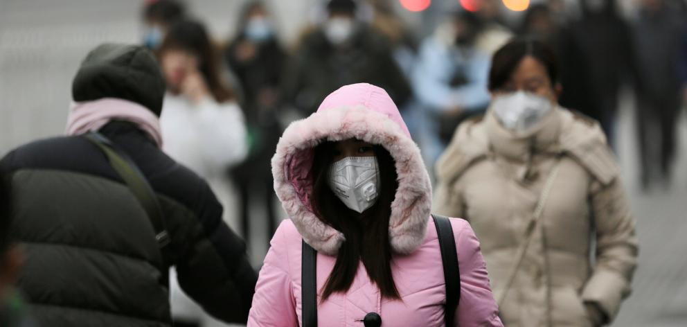Commuters wear masks to counter smog in Beijing this week. Photo: Reuters