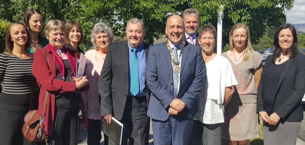 Mayor Tim Cadogan (front) is pictured with the group, following the citizenship ceremony. They ...