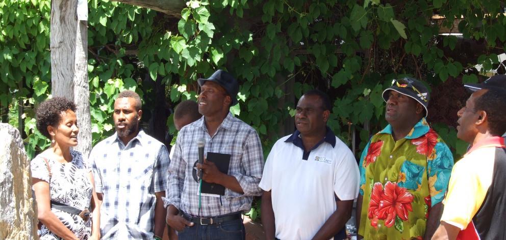 Singing the national anthem of Vanuatu during the 10th anniversary celebration of Seasonal...