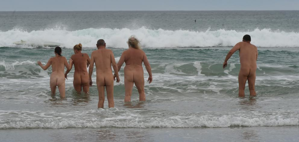 A small group of naturists brave the cold southern waters at St Kilda Beach yesterday for the Southern Free Beaches 5th Annual Mid-Summer Skinny Dip. Free Beaches New Zealand Inc is a society that defends the rights of skinny dippers and beach naturists.