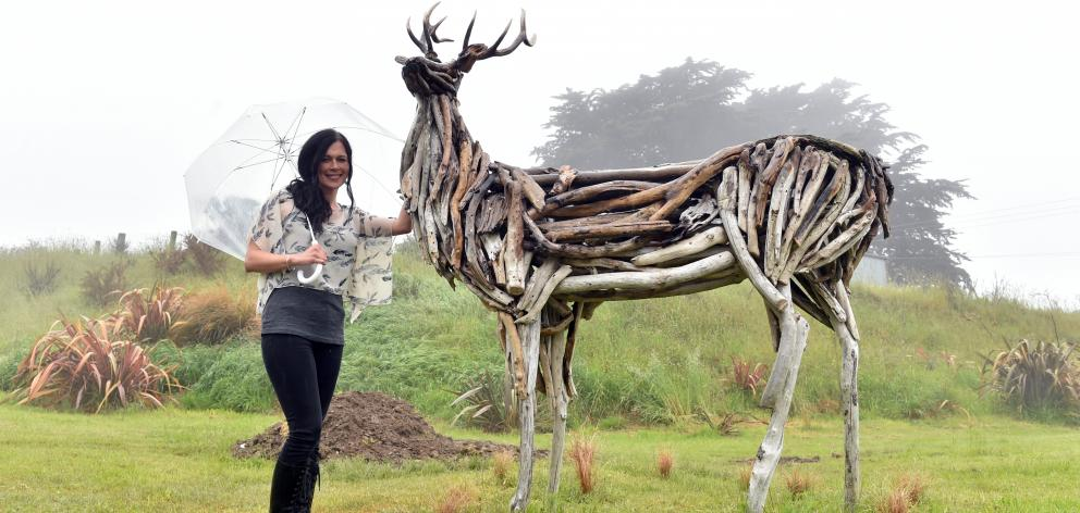 Sharon Cunningham with a stag she created from driftwood. Photo: Gregor Richardson.