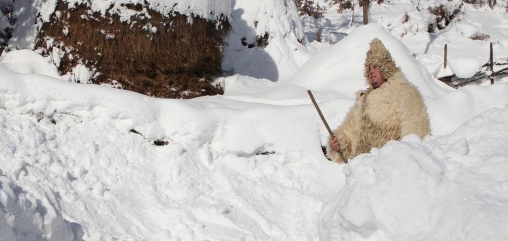 A man walks in deep snow in the village of Jezerc, Kosovo. Photo Reuters