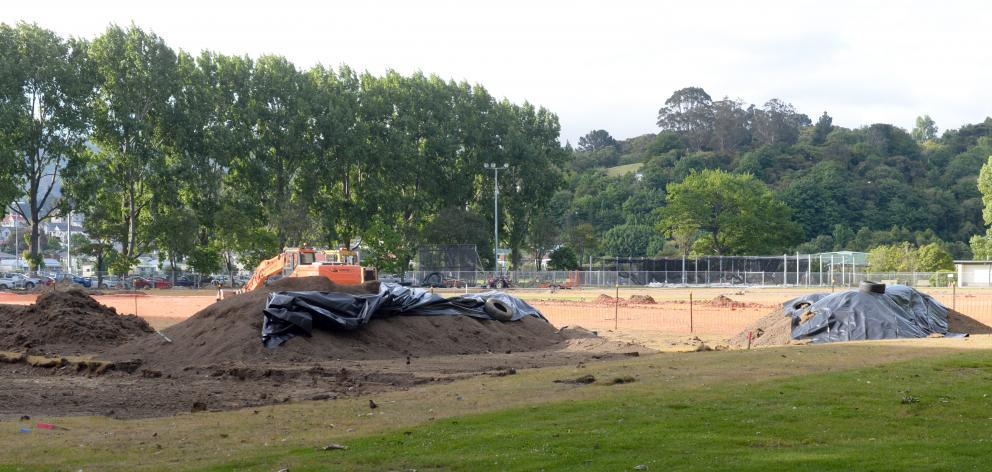 Plastic covers mounds of earth where asbestos was discovered at Dunedin's Logan Park last month....