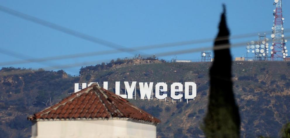 "The iconic Hollywood sign in Los Angeles was vandalised to read ""Hollyweed"". Photo: Reuters"