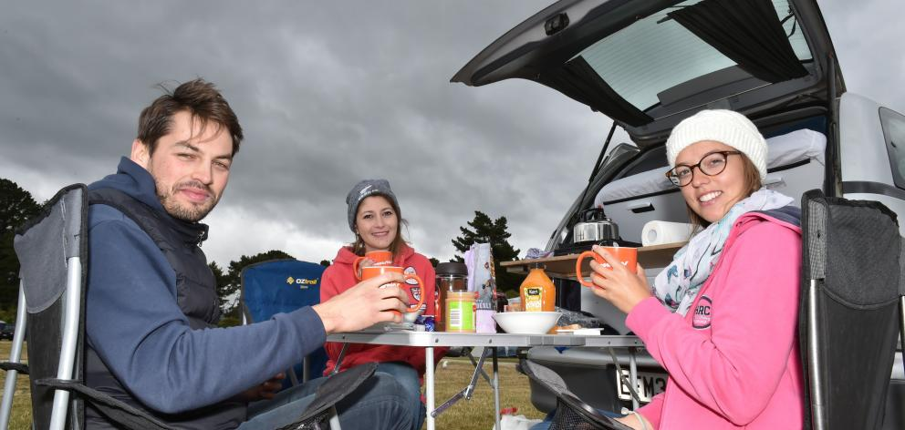 French tourists eating breakfast at Warrington Domain on Saturday (from left) Thomas Ledein (27)...