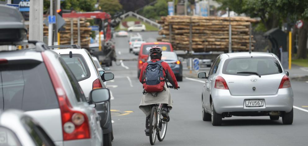 A cyclist negotiates Albany St, a priority area for a planned campus safety and accessibility...