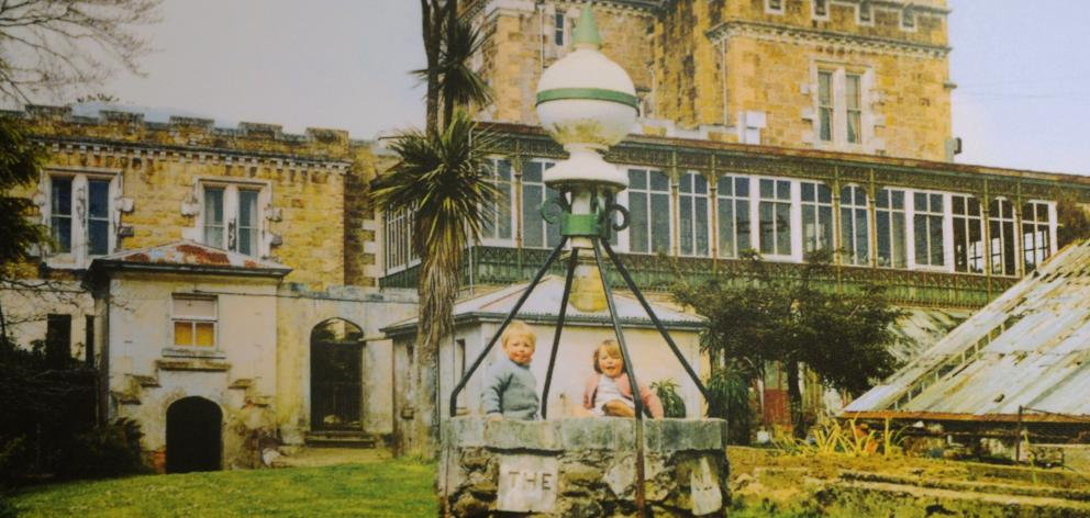 Norcombe and Sophie Barker play in an empty well in the Larnach Castle grounds in the 1960s....