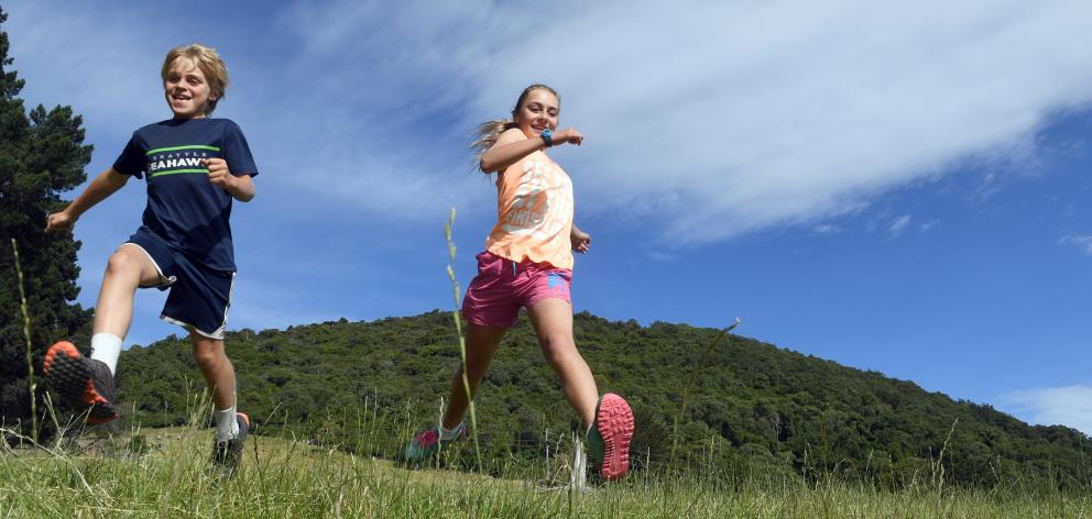 Siblings Eleanor (12) and Charlie (10) Baldi, of Dunedin, were the first up and down Saddle Hill...