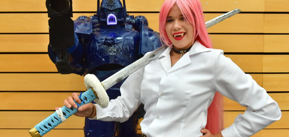 Cameron Lindsay, as a Night Lords Chaos Space Marine from Warhammer 40K, and Elise Henry, as Moka...