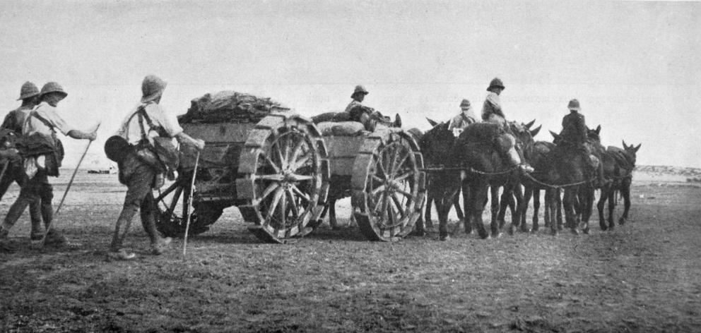 British troops crossing the desert in western Egypt with an artillery limber on ``hoof'' wheels, drawn by mules. - Otago Witness, 14.3.1917.