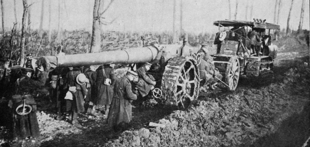 A British big gun is hauled by caterpillar tractor along a muddy road to the front in Northern France. - Otago Witness, 7.3.1917.