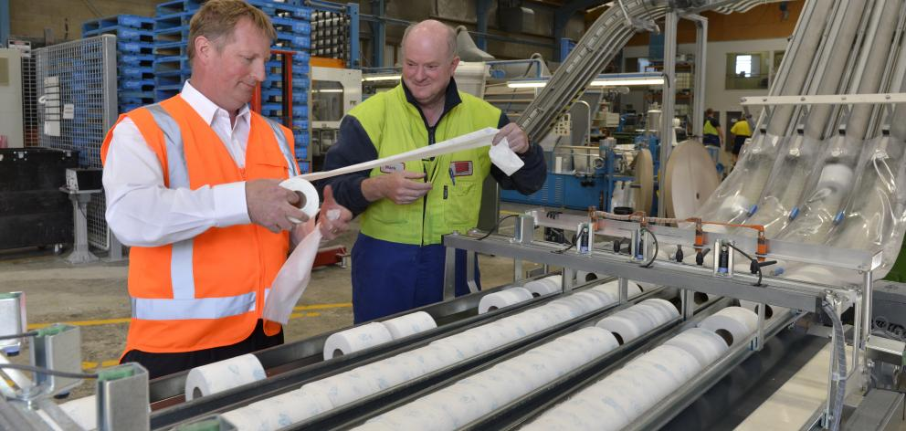 Cottonsoft operations manager Chris Batchelor (left) and operator Mark Bradshaw at the Cottonsoft factory yesterday. Photo by Gerard O'Brien.