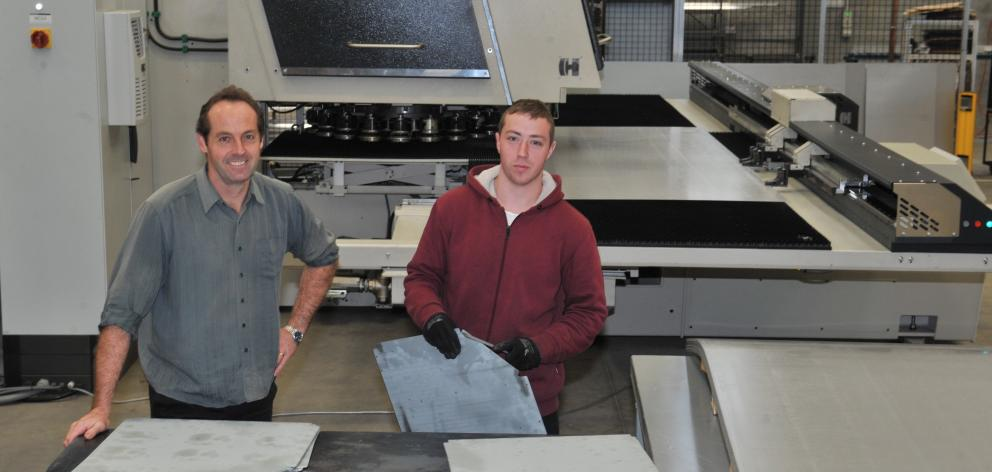 Escea operations manager Mark Davie (left) and machine operator Ryan Savage with the new turret...